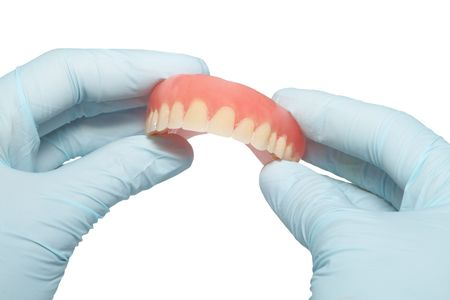 molars: Demountable tooth prostheses in hands of the dentist