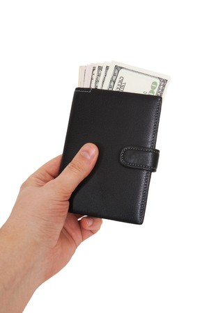 Hand holding a black wallet with many photo