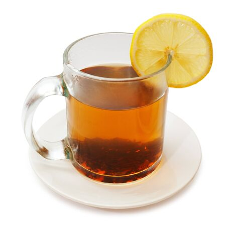 Glass cup of tea with lemon on a white background photo
