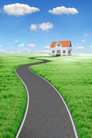 country house: Road to House on green meado Stock Photo