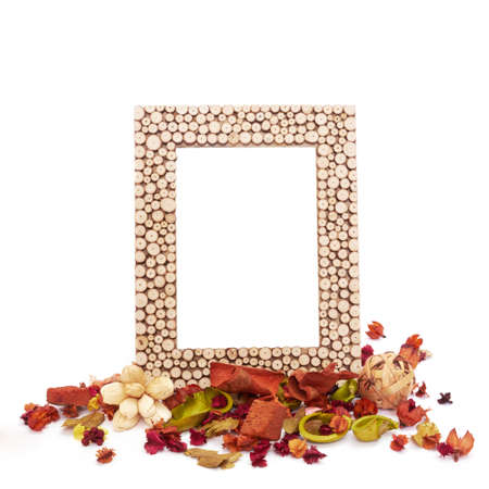Empty picture frame with dried flowers and leaves. Isolated on white photo