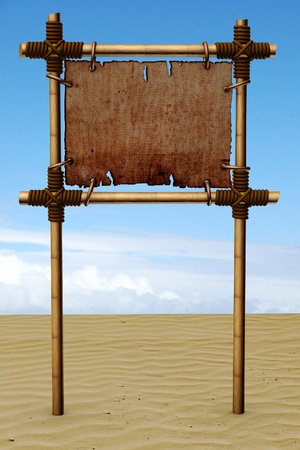 Signboard from bamboo sticks, on a sandy beach Stock Photo - 9151449