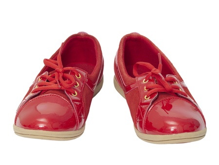 Red shiny shoes on white background. photo