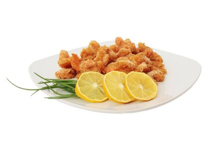 breaded: Fried shrimp on a plate. Isolated on white Stock Photo