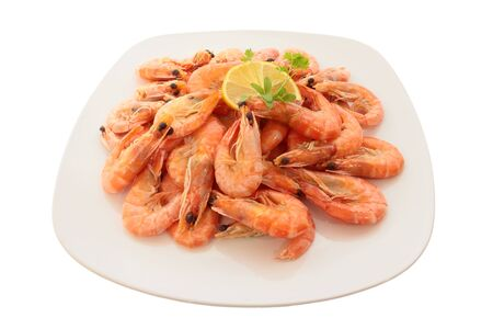 Cooked shrimp on a large plate. Isolated on white photo