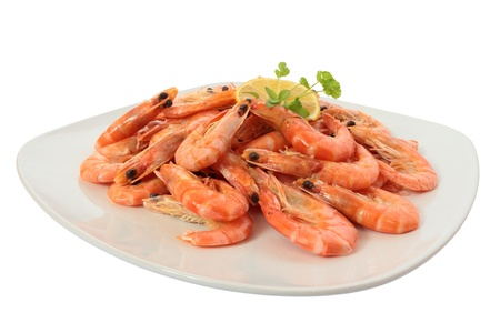 Cooked shrimp on a large plate. Isolated on white