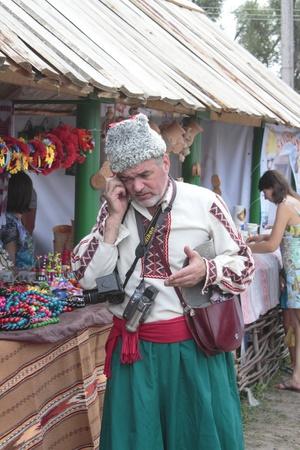 cossack: VELYKI SOROCHINTSY, UKRAINE - AUGUST 16: Participants of fair National sorochinskiy yarmarok, August 16, 2011 in Velyki Sorochintsy of Poltava state, Ukraine