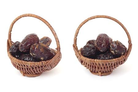 Basket of dates. Isolated on white photo