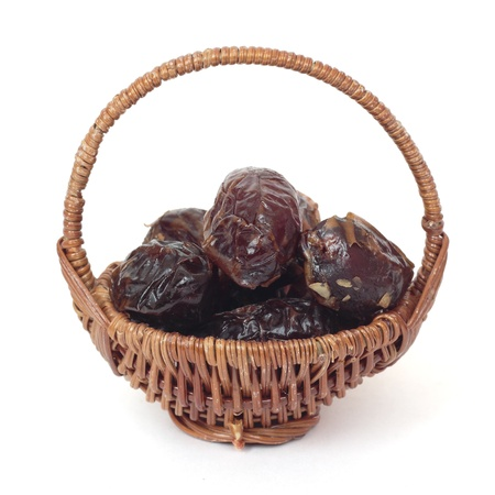 willow fruit basket: Basket of dates. Isolated on white