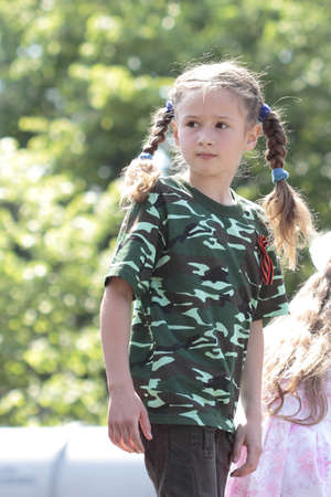 KHARKIV, UKRAINE - MAY 09: Children on  military equipment of Victory Day on Freedom Square on May 09, 2012 in Kharkiv, Ukraine. Stock Photo - 13685877