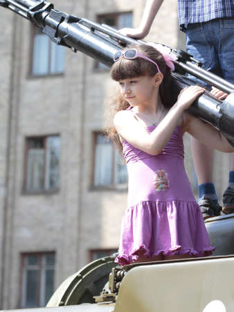 KHARKIV, UKRAINE - MAY 09: Children on  military equipment of Victory Day on Freedom Square on May 09, 2012 in Kharkiv, Ukraine. Stock Photo - 13685892