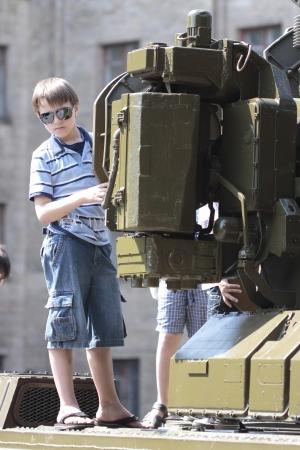 KHARKIV, UKRAINE - MAY 09: Children on  military equipment of Victory Day on Freedom Square on May 09, 2012 in Kharkiv, Ukraine. Stock Photo - 13685897
