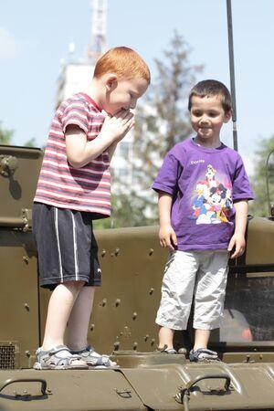 KHARKIV, UKRAINE - MAY 09: Children on military equipment of Victory Day on Freedom Square on May 09, 2012 in Kharkiv, Ukraine.