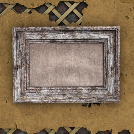 Old frame on a very decrepit wall photo