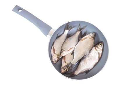 european roach: Fish fry in a frying pan  Isolated on white