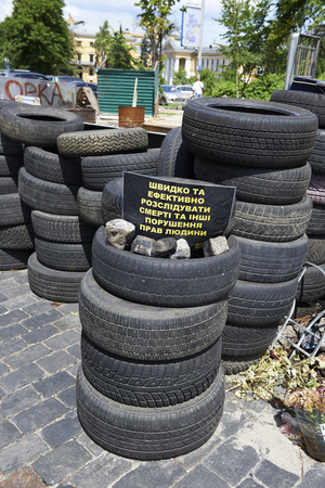 dignity: KIEV, UKRAINE - June 13, 2014: Kiev Maidan after the revolution of dignity. Inscription on the barricades: Quickly and effectively investigate the death and other human rights violations Editorial