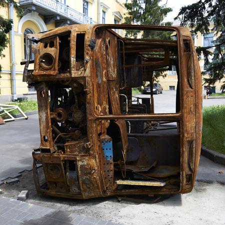 insurrection: KIEV, UKRAINE - June 13, 2014: Kiev Maidan after the revolution of dignity. Burned bus near October Palace.