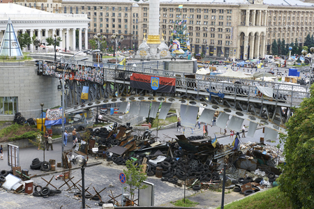 outcry: KIEV, UKRAINE - June 13, 2014: Kiev Maidan after the revolution of dignity. Barricades protesters made of tires