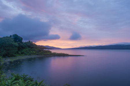 A gorgeous sunset begins to paint the waters of Lake Arenal, Costa Rica