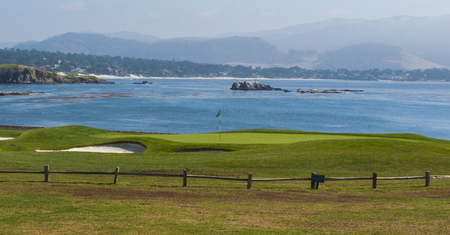 A beautiful ocean view on the 18th green at prestigeous Pebble Beach in Monterey California Reklamní fotografie