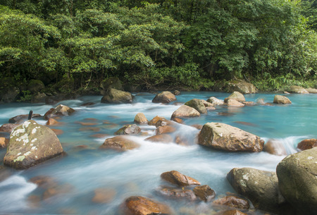 Glacier like water races past river rock in Costa Rica Reklamní fotografie