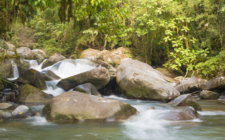 sooth: A beautiful river in the Talamanca mountains of Costa Rica runs pure and swift. Stock Photo