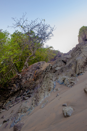 A slope of sand and beautiful background of nature in Costa Rica.