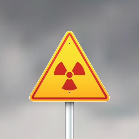 Triangular radiation sign on dark gray sky background.