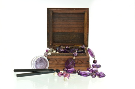 Open wooden gift box with eye shadow photo