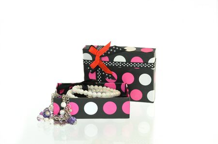 Open gift box and jewelry photo