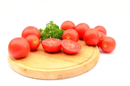 Tomatoes on wooden plate