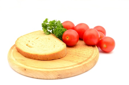 Bread and cherry tomatoes photo
