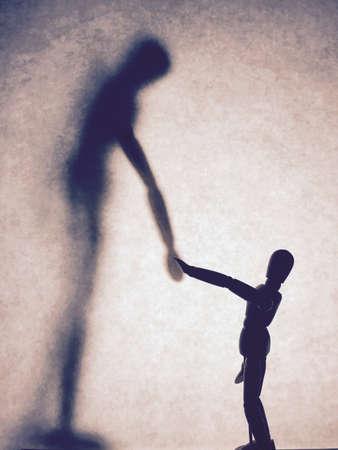 wood figurine: Wooden figurine and shadow