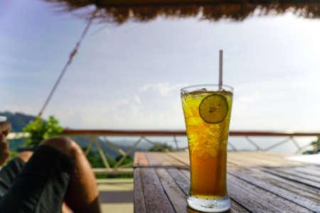 Lemon ice tea glass on tropical terrace with sea view on Samui island, Thailand Banco de Imagens