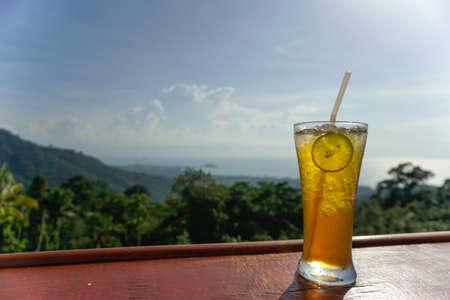 Lemon ice tea glass with sea view on Samui island, Thailand Banco de Imagens