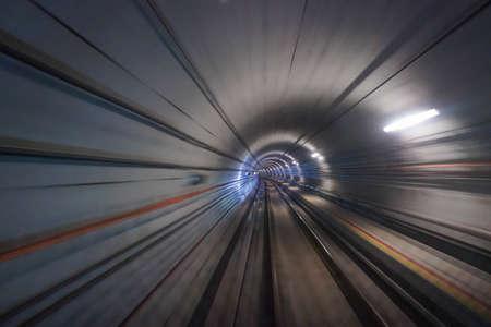 Riding train through subway tunnel in Singapore