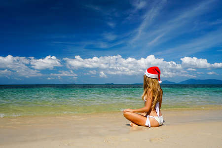 Woman on the Beach with Santa Claus Hat shot with a Sony a6300