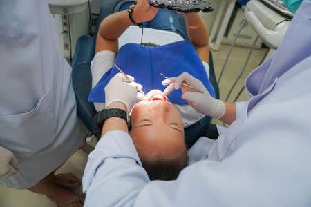 Woman Fix Teeth at Dental Clinic