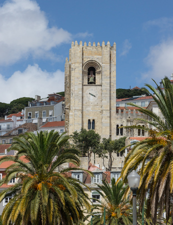 Cathedral belltower against clouds and the sky to Lisbon, Portugal photo