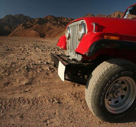 Red offroad Car on desert, Egypt