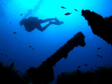 Alone scuba diver in deep sea    Stock Photo