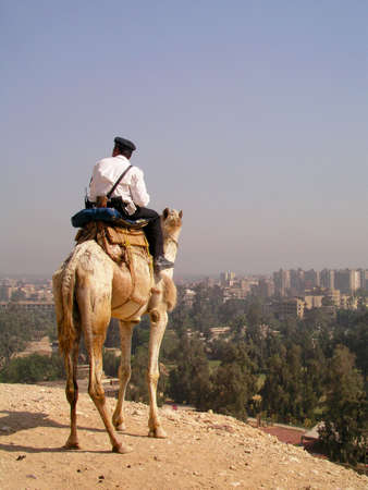 Egyptian policeman looks on Cairo Stock Photo