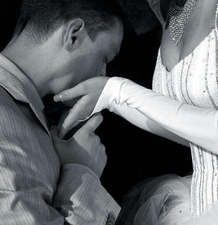 descendants: The groom kisses hands to the bride