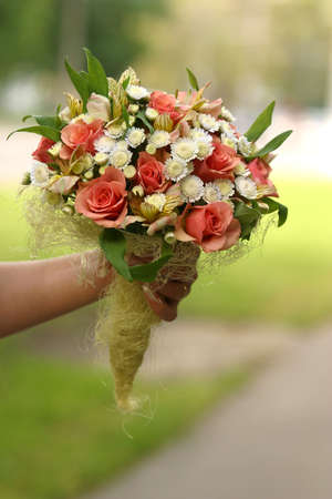 Wedding bouquet in a hand of the bride Stock Photo - 504003