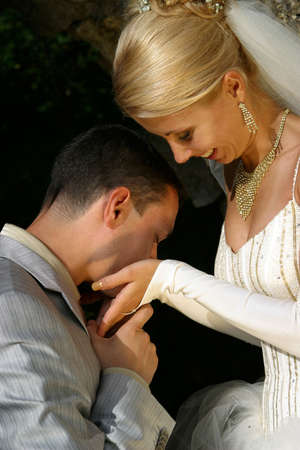 descendants: The groom kisses palms to the bride Stock Photo
