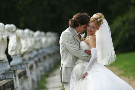 descendants: Newly-married couple. The groom kisses the bride