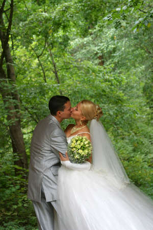 futurity: Newly-married couple. The groom kisses the bride