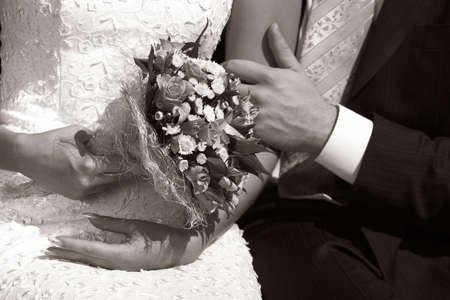 Wedding bouquet in hands of the bride. b/w+sepia Stock Photo - 524527