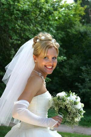 The beautiful bride smiles