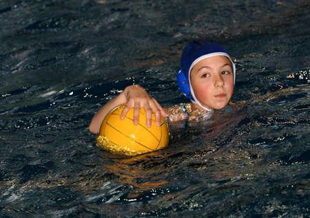 Teenage girl playing waterpolo Stock Photo - 542580